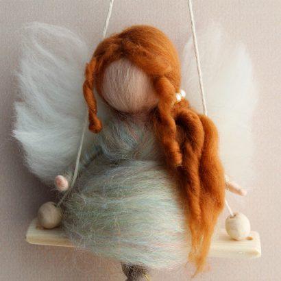 Детская кукла рыжий ангел на качели